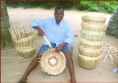A student weaving baskets to support himself.
