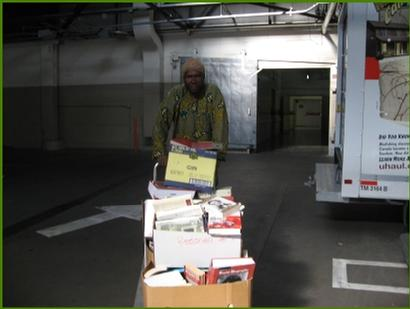 Taking book donations to our storage in a U-Haul facility